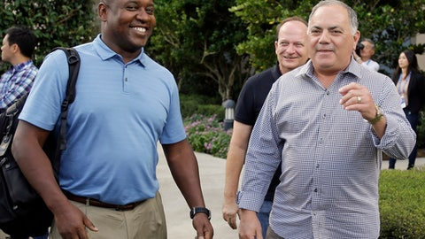 Michael Hill, left, president of baseball operations for the Miami Marlins and Al Avila, right, executive vice president of baseball operations and general manager of the Detroit Tigers greet members of the media at the annual MLB baseball general managers' meetings, Tuesday, Nov. 14, 2017, in Orlando, Fla. (AP Photo/John Raoux)