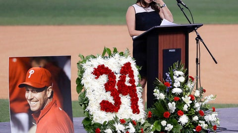 Brandy Halladay, wife of late pitcher Roy Halladay, wipes her eyes while talking about her husband during an event honoring his life, at Spectrum Field in Clearwater, Fla., Tuesday, Nov. 14, 2017. Halladay, a two-time Cy Young Award winner, died Nov. 7 at age 40 when the private plane he was piloting crashed into the Gulf of Mexico off the coast of Florida. (Yong Kim/The Philadelphia Inquirer via AP)
