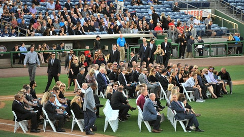 Family, friends, teammates gather on the baseball diamond during a memorial tribute for Roy Halladay, who died last week in a small plane crash, at the Philadelphia Phillies' spring training baseball stadium, Tuesday, Nov. 14, 2017, in Clearwater, Fla. (AP Photo/Steve Nesius)