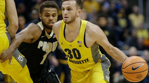 Marquette's Andrew Rowsey drives past Purdue's Aaron Wheeler during the first half of an NCAA college basketball game, Tuesday, Nov. 14, 2017, in Milwaukee. (AP Photo/Tom Lynn)