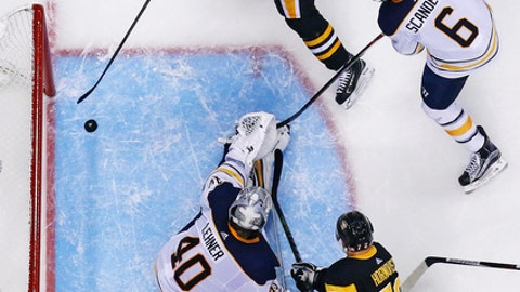 Pittsburgh Penguins' Sidney Crosby (87) puts a rebound behind Buffalo Sabres goalie Robin Lehner (40) for a goal in the second period of an NHL hockey game in Pittsburgh, Tuesday, Nov. 14, 2017. The Penguins won 5-4 in overtime. (AP Photo/Gene J. Puskar)