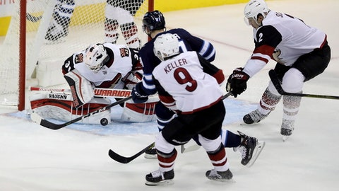 Winnipeg Jets' Kyle Connor (81) is stopped by Arizona Coyotes goaltender Scott Wedgewood (31) with Clayton Keller (9) and Luke Schenn (2) trailing during third period NHL hockey action in Winnipeg, Manitoba, Tuesday, Nov. 14, 2017. (Trevor Hagan/The Canadian Press via AP)