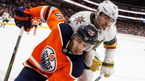 Vegas Golden Knights' Alex Tuch (89) and Edmonton Oilers' Darnell Nurse (25) work in the corner during the third period of an NHL hockey game Tuesday, Nov. 14, 2017, in Edmonton, Alberta. (Jason Franson/The Canadian Press via AP)
