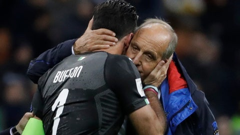 "FILE - In this Monday, Nov. 13, 2017 file photo, Italy goalkeeper Gianluigi Buffon is comforted by Italy coach Gian Piero Ventura, right, at the end of the World Cup qualifying play-off second leg soccer match between Italy and Sweden, at the Milan San Siro stadium, Italy.  Italy coach Gian Piero Ventura has been fired Wednesday, Nov. 15, 2017 following the Azzurri's failure to qualify for the World Cup. Ventura leaves in disgrace, widely criticized for his tactical decisions that left Italy out of football's biggest competition for the first time in six decades. A football federation statement says Ventura is ""no longer coach of the national team."" (AP Photo/Luca Bruno, File)"