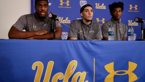 UCLA basketball player Cody Riley, left, reads his statement as he is joined by teammates LiAngelo Ball, center, and Jalen Hill during a news conference at UCLA Wednesday, Nov. 15, 2017, in Los Angeles. Three UCLA NCAA college basketball players accused of shoplifting in China admitted to the crime and apologized before coach Steve Alford announced they were being suspended indefinitely. (AP Photo/Jae C. Hong)