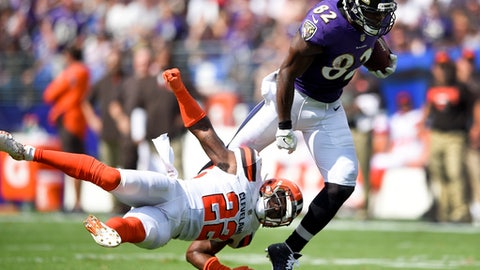 FILE - In this Sept. 17, 2017, file photo, Baltimore Ravens tight end Benjamin Watson (82) carries the ball past Cleveland Browns free safety Jabrill Peppers (22) during the first half of an NFL football game in Baltimore. At 36 years old and coming off an Achilles tendon injury that cost him the entire 2016 season, Watson has become an integral part of the Ravens' passing game. (AP Photo/Nick Wass, File)