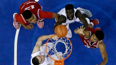 Indiana forward Juwan Morgan, top left, watches as teammate forward Justin Smith, bottom right, goes up for a shot against Seton Hall forward Ismael Sanogo, top right, and forward Sandro Mamukelashvili during the first half of an NCAA college basketball game, Wednesday, Nov. 15, 2017, in Newark, N.J. (AP Photo/Julio Cortez)