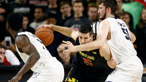Maryland center Michal Cekovsky, center, of Slovakia, drives between Butler center Nate Fowler, right, and guard Kamar Baldwin during the first half of an NCAA college basketball game in College Park, Md., Wednesday, Nov. 15, 2017. (AP Photo/Patrick Semansky)