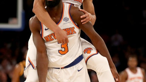 NEW YORK, NY - NOVEMBER 15:  Tim Hardaway Jr. #3 of the New York Knicks is congratulated by teammate Courtney Lee #5 after Hardaway Jr. hit a three point shot in the final minutes of the game against the Utah Jazz at Madison Square Garden on November 15, 2017 in New York City. NOTE TO USER: User expressly acknowledges and agrees that, by downloading and or using this Photograph, user is consenting to the terms and conditions of the Getty Images License Agreement  (Photo by Elsa/Getty Images)