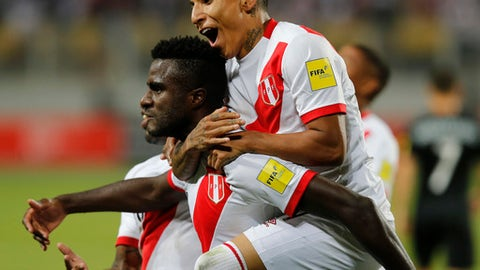 Peru's Raul Ruidiaz rides on the back of teammate Christian Ramos, after Ramos scored his team's second goal against New Zealand during a play-off qualifying match for the 2018 Russian World Cup in Lima, Peru, Wednesday, Nov. 15, 2017. (AP Photo/Karel Navarro)
