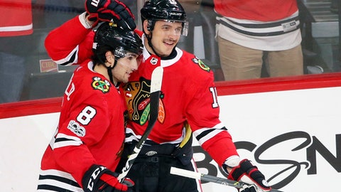 Chicago Blackhawks' Artem Anisimov (15) celebrates his hat trick goal with Nick Schmaltz (8) during the third period of an NHL hockey game against the New York Rangers, Wednesday, Nov. 15, 2017, in Chicago. The Blackhawks won 6-3. (AP Photo/Charles Rex Arbogast)