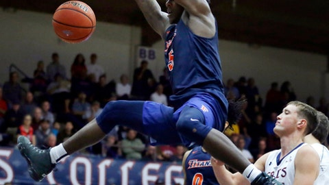 Cal State Fullerton's Davon Clare (5) scores over Saint Mary's Cullen Neal during the first half of an NCAA college basketball game Wednesday, Nov. 15, 2017, in Moraga, Calif. (AP Photo/Ben Margot)