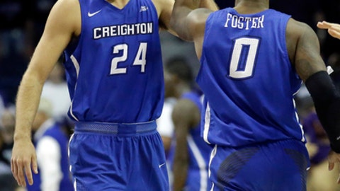 Creighton guard Mitch Ballock, left, celebrates with guard Marcus Foster after Creighton defeated Northwestern 92-88 in an NCAA college basketball game, Wednesday, Nov. 15, 2017, in Rosemont, Ill. (AP Photo/Nam Y. Huh)