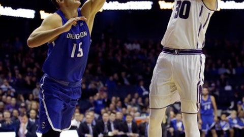 Northwestern guard Bryant McIntosh, right, shoots against Creighton forward Martin Krampelj during the second half of an NCAA college basketball game, Wednesday, Nov. 15, 2017, in Rosemont, Ill. Creighton won 92-88. (AP Photo/Nam Y. Huh)