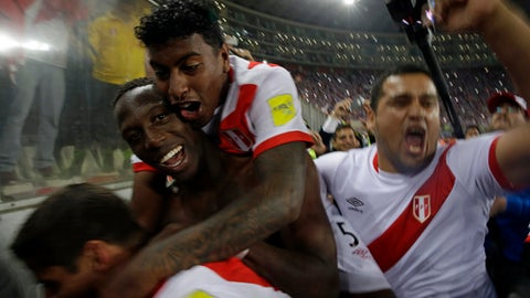 Peru's players celebrate after a play-off qualifying match for the 2018 Russian World Cup against New Zealand in Lima, Peru, Wednesday, Nov. 15, 2017. Peru beat New Zealand 2-0 to win a two-leg playoff and earn the 32nd and last spot in the World Cup field in Russia.(AP Photo/Rodrigo Abd)7