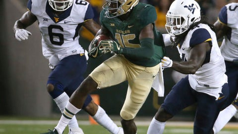 FILE - In this Oct. 21, 2017, file photo, Baylor wide receiver Denzel Mims (15) runs past West Virginia safety Dravon Askew-Henry (6) and cornerback Mike Daniels Jr. (4) during the first half of an NCAA college football game in Waco, Texas. Mims had 152 yards receiving last week, giving him 1,001 for the season. (AP Photo/Jerry Larson, File)