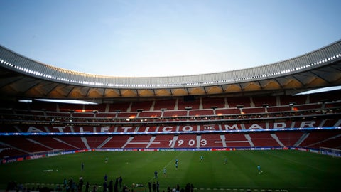 FILE - This is a  Tuesday, Sept. 26, 2017. file photo of the Wanda Metropolitano stadium in Madrid.  With Atletico Madrid's president and other club officials standing by the team's shield, an archbishop celebrated the ceremony to bless the Wanda Metropolitano Stadium. Former players and priests were also present at the private ritual by the pitch of the 68,000-capacity venue in mid November. (AP Photo/Francisco Seco)