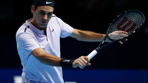 Roger Federer of Switzerland plays a return to Marin Cilic of Croatia during their mens singles match at the ATP World Finals at the O2 Arena in London, Thursday, Nov. 16, 2017. (AP Photo/Alastair Grant)