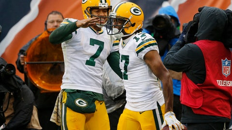 FILe - In this Nov. 12, 2017, file photo, Green Bay Packers quarterback Brett Hundley (7) celebrates a touchdown with wide receiver Davante Adams (17) during the second half of an NFL football game against the Chicago Bears, in Chicago. Third-year backup Hundley has made gradual strides over his three starts, to the point where the Packers snapped a three-game losing streak with a 23-16 victory last week over the Chicago Bears. The Packers play the Ravens on Sunday at Lambeau Field. (AP Photo/Charles Rex Arbogast, File)