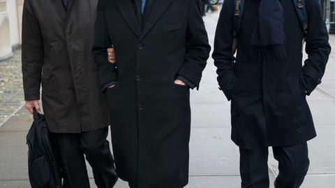 Jose Maria Marin, center, arrives at federal court in the Brooklyn borough of New York, Thursday, Nov. 16, 2017. Marin is one of three former South American soccer officials who are going on trial in a U.S. case highlighting widespread corruption in the sport's governing body.  (AP Photo/Craig Ruttle)