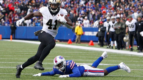 FILE - In this Nov. 12, 2017, file photo, New Orleans Saints running back Alvin Kamara (41) rushes past Buffalo Bills' Shareece Wright (20) during the first half of an NFL football game in Orchard Park, N.Y. As usual, Drew Brees has the passing game humming, and the contributions of the running back tandem of Mark Ingram and rookie Alvin Kamara has made New Orleans even more dynamic with the ball. The Washington Redskins play at New Orleans on Sunday.(AP Photo/Jeffrey T. Barnes, File)