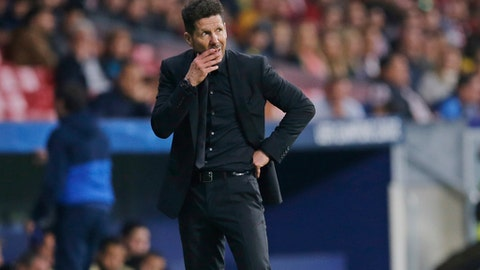 FILE - In this Tuesday, Oct. 31, 2017 file photo, Atletico coach Diego Simeone watches the game during their Group C Champions League soccer match against Qarabag at the Metropolitano stadium in Madrid, Spain. Real Madrid plays its first derby at Atletico Madrid's new Wanda Metropolitano Stadium on Saturday, Nov. 18. Diego Simeone's team has won only two of its last nine games in all competitions. (AP Photo/Paul White, file)