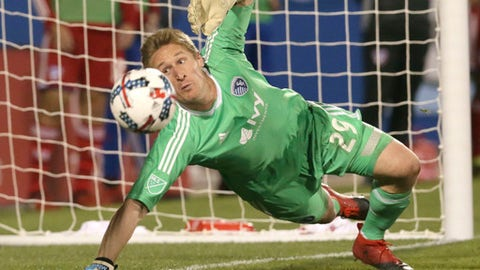 FILE - In this April 22, 2017, file photo, Sporting Kansas City goalkeeper Tim Melia (29) defends the goal during the second half of an MLS soccer match against FC Dallas in Frisco, Texas. Melia has been named Major League Soccer's Goalkeeper of the Year, Thursday, Nov. 16, 2017.  (AP Photo/LM Otero, File)