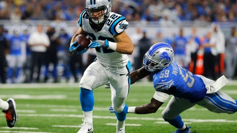 FILE - In this Oct. 8, 2017, file photo, Carolina Panthers running back Christian McCaffrey (22) scores on a 6-yard shovel pass as Detroit Lions outside linebacker Tahir Whitehead (59) misses the tackle during an NFL football game in Detroit. The Panthers enter the bye weekend having won three straight, leaving them at 7-3 and a half-game behind the New Orleans Saints in the NFC South. (AP Photo/Paul Sancya, File)