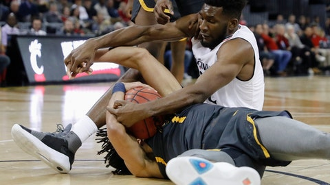 Cincinnati's Eliel Nsoseme, right, and Coppin State's Chad Andrews-Fulton, below, wrestle for the ball during the first half of an NCAA college basketball game, Thursday, Nov. 16, 2017, in Cincinnati. (AP Photo/John Minchillo)