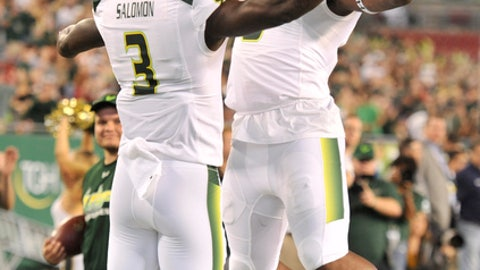 South Florida's Tyre McCants, right, celebrates with Darnell Salomon (3) after Salomon's touchdown against Tulsa during the first half of an NCAA college football game Thursday, Nov. 16, 2017, in Tampa, Fla. (AP Photo/Steve Nesius)