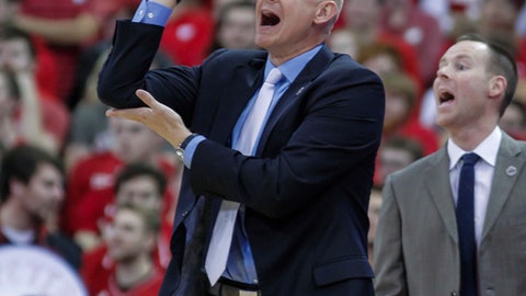 Xavier coach Chris Mack yells to his team during the first half of an NCAA college basketball game against Wisconsin on Thursday, Nov. 16, 2017, in Madison, Wis. (AP Photo/Andy Manis)
