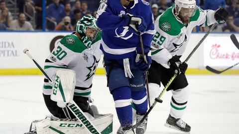 Tampa Bay Lightning center Vladislav Namestnikov, (90), of Russia, tries to deflect a shot past Dallas Stars goalie Ben Bishop (30) and defenseman Greg Pateryn (29) during the second period of an NHL hockey game Thursday, Nov. 16, 2017, in Tampa, Fla. (AP Photo/Chris O'Meara)