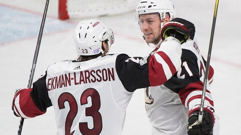 Arizona Coyotes' Derek Stepan, right, celebrates with teammate Oliver Ekman-Larsson after scoring against the Montreal Canadiens during third-period NHL hockey game action in Montreal, Thursday, Nov. 16, 2017. (Graham Hughes/The Canadian Press via AP)