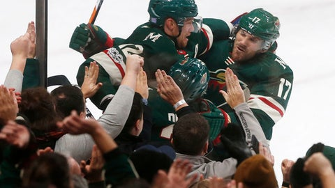 Minnesota Wild's Eric Staal is congratulated by Marcus Foligno on Foligno's goal off Nashville Predators goalie Pekka Rinne of Finland in the third period of an NHL hockey game Thursday, Nov. 16, 2017 in St. Paul, Minn. The Wild won 6-4. (AP Photo/Jim Mone)