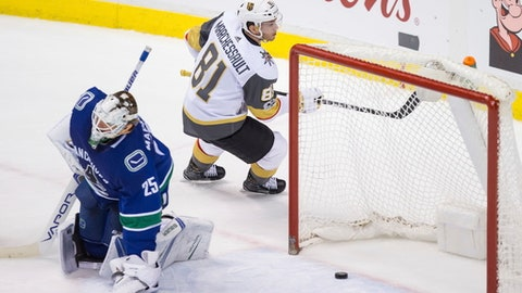 Vegas Golden Knights' Jonathan Marchessault (81) scores against Vancouver Canucks goalie Jacob Markstrom, of Sweden, during the third period of an NHL hockey game Thursday, Nov. 16, 2017, in Vancouver, British Columbia. (Darryl Dyck/The Canadian Press via AP)