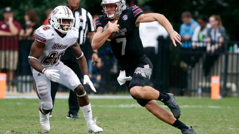FILE - In this Nov. 4, 2017, file photo, Mississippi State quarterback Nick Fitzgerald (7) runs for a first down past Massachusetts linebacker Jarell Addo (26) during the second half of an NCAA college football game in Starkville, Miss. Mississippi State plays Arkansas this week.  (AP Photo/Rogelio V. Solis, File)