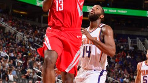 PHOENIX, AZ - NOVEMBER 16:  James Harden #13 of the Houston Rockets dunks against Greg Monroe #14 of the Phoenix Suns on November 16, 2017 at Talking Stick Resort Arena in Phoenix, Arizona. NOTE TO USER: User expressly acknowledges and agrees that, by downloading and or using this photograph, user is consenting to the terms and conditions of the Getty Images License Agreement. Mandatory Copyright Notice: Copyright 2017 NBAE (Photo by Barry Gossage/NBAE via Getty Images)
