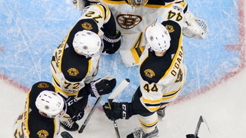 Boston Bruins goalie Anton Khudobin, top, of Kazakhstan, is congratulated by teammates after the Bruins defeated the Los Angeles Kings 2-1 in an NHL hockey game, Thursday, Nov. 16, 2017, in Los Angeles. (AP Photo/Mark J. Terrill)