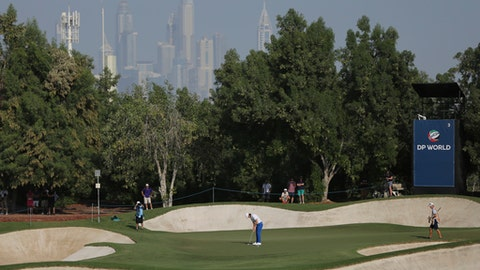 Tommy Fleetwood of England plays a shot on the third hole during the second round of the DP World Tour Championship golf tournament in Dubai, United Arab Emirates, Friday, Nov. 17, 2017. (AP Photo/Kamran Jebreili)