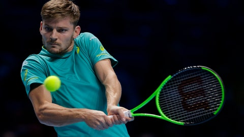 David Goffin of Belgium plays a return to Dominic Thiem of Austria during their men's singles tennis match at the ATP World Finals at the O2 Arena in London, Friday, Nov. 17, 2017. (AP Photo/Alastair Grant)