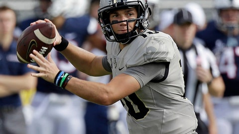 FILE - In this Saturday, Nov. 11, 2017, file photo, Central Florida quarterback McKenzie Milton (10) throws a pass against Connecticut during the first half of an NCAA college football game in Orlando, Fla. Quarterback Milton McKenzie is averaging 10.8 yards per pass attempt as the offense tries to stretch defenses vertically with its speedy receivers(AP Photo/John Raoux, File)