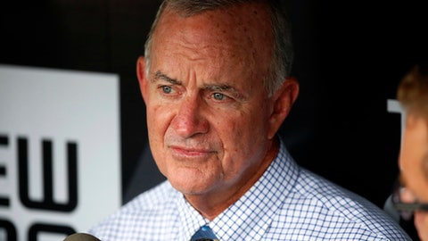 FILE - In this May 17, 2016, file photo, Atlanta Braves President of Baseball Operations John Hart, center, talks with reporters in the dugout before a baseball game against the Pittsburgh Pirates in Pittsburgh. John Hart has left the Atlanta Braves, less than a week after being stripped of his role as president of baseball operations. The decision announced Friday, Nov. 17, 2017, was not unexpected given the hiring of general manager Alex Anthopoulos, who now has autonomy over all baseball-related decisions.  (AP Photo/Gene J. Puskar, File)