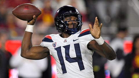 FILE - In this Nov. 4, 2017, file photo, Arizona quarterback Khalil Tate throws a pass during the first half of an NCAA college football game against Southern California in Los Angeles. Tate's fantastic season is earning him Heisman buzz. He leads the nation with five 70-plus yard runs, four of them for touchdowns, the longest run for a quarterback (82 yards) and his 327 yards rushing against Colorado set a single-game record for a quarterback. Arizona plays Oregon in Eugene, Ore., Saturday, Nov. 18, 2017. (AP Photo/Mark J. Terrill, File)