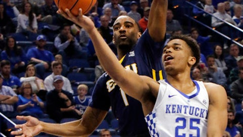 Kentucky's Pj Washington (25) shoots while defended by East Tennessee State's Desonta Bradford (1) during the first half of an NCAA college basketball game, Friday, Nov. 17, 2017, in Lexington, Ky. (AP Photo/James Crisp)
