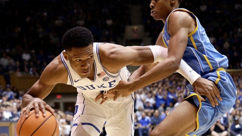 Duke's Trevon Duval dribbles the ball while Southern's Chris Thomas guards during the first half of an NCAA college basketball game in Durham, N.C., Friday, Nov. 17, 2017. (AP Photo/Gerry Broome)