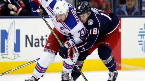 New York Rangers defenseman Ryan McDonagh, left, works against Columbus Blue Jackets forward Pierre-Luc Dubois during the second period of an NHL hockey game in Columbus, Ohio, Friday, Nov. 17, 2017. (AP Photo/Paul Vernon)