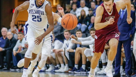 Villanova guard Mikal Bridges runs after the ball against Lafayette forward Paulius Zalys during the first half of an NCAA college basketball game Friday, Nov. 17, 2017, in Allentown, Pa. (Young KimY/The Philadelphia Inquirer via AP)