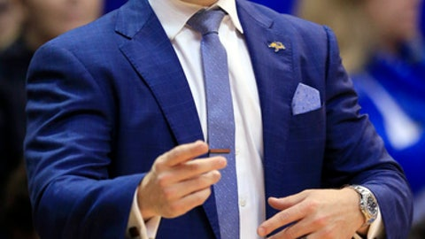 South Dakota State coach T.J. Otzelberger shouts to his team during the first half of an NCAA college basketball game against Kansas in Lawrence, Kan., Friday, Nov. 17, 2017. (AP Photo/Orlin Wagner)