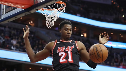 WASHINGTON, DC - NOVEMBER 17: Hassan Whiteside #21 of the Miami Heat dunks the ball in the first half against the Washington Wizards at Capital One Arena on November 17, 2017 in Washington, DC. NOTE TO USER: User expressly acknowledges and agrees that, by downloading and or using this photograph, User is consenting to the terms and conditions of the Getty Images License Agreement. (Photo by Rob Carr/Getty Images)