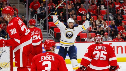 Buffalo Sabres right wing Kyle Okposo (21) celebrates a goal by Ryan O'Reilly against the Detroit Red Wings during the third period of an NHL hockey game Friday, Nov. 17, 2017, in Detroit. (AP Photo/Paul Sancya)